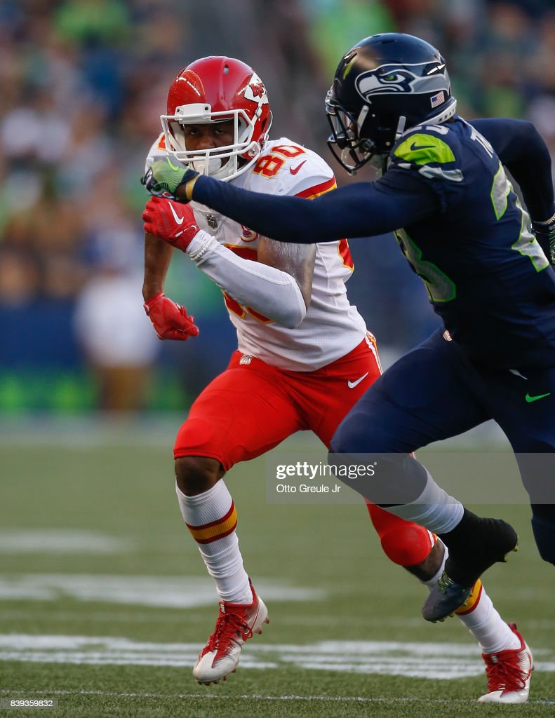 Wide receiver Jehu Chesson #80 of the Kansas City Chiefs runs a pass route against cornerback Neiko Thorpe #23 of the Seattle Seahawks at CenturyLink Field on August 25, 2017 in Seattle, Washington.
