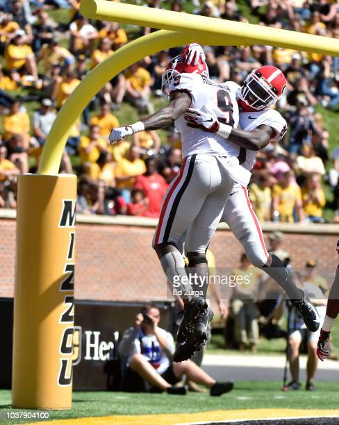 wide receiver Jeremiah Holloman of the Georgia Bulldogs celebrates his touchdown with teammate wide receiver Riley Ridley in the third quarter...