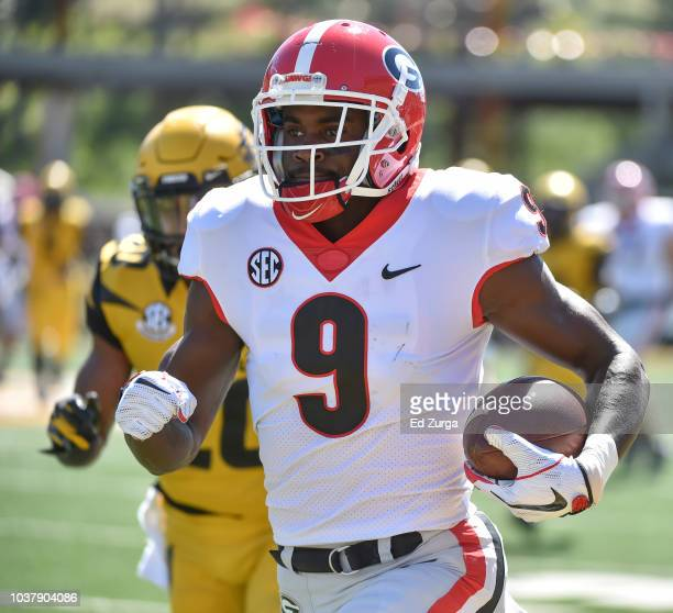 Wide receiver Jeremiah Holloman of the Georgia Bulldogs for a touchdown reception against defensive back Khalil Oliver of the Missouri Tigers in the...