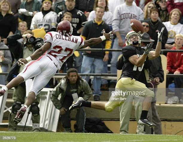 Wide receiver Jeremy Bloom of the Colorado Buffaloes catches a 33yard pass against defensive back Erik Coleman of the Washington State Cougars to set...