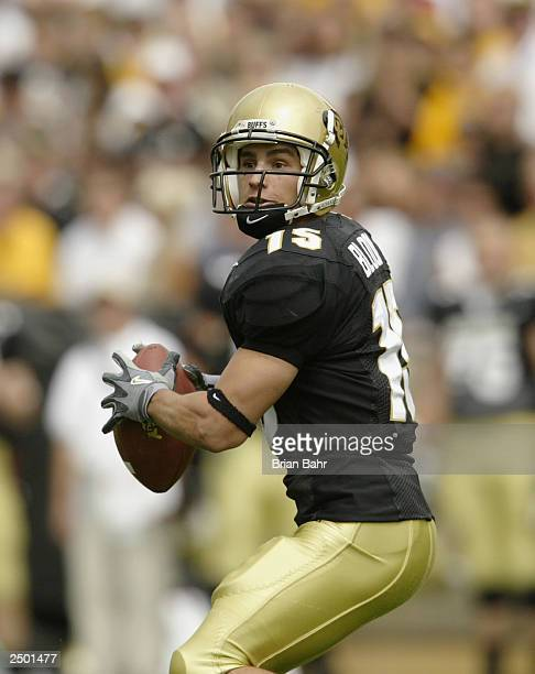 Wide receiver Jeremy Bloom of the Colorado Buffaloes prepares to throw the ball against the UCLA Bruins on September 6 2003 at Folsom Field in...