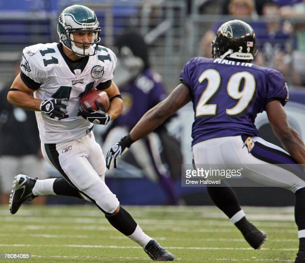 Wide receiver Jeremy Bloom of the Philadelphia Eagles looks to avoid cornerback Derrick Martin of the Baltimore Ravens in a pre-season game at the...