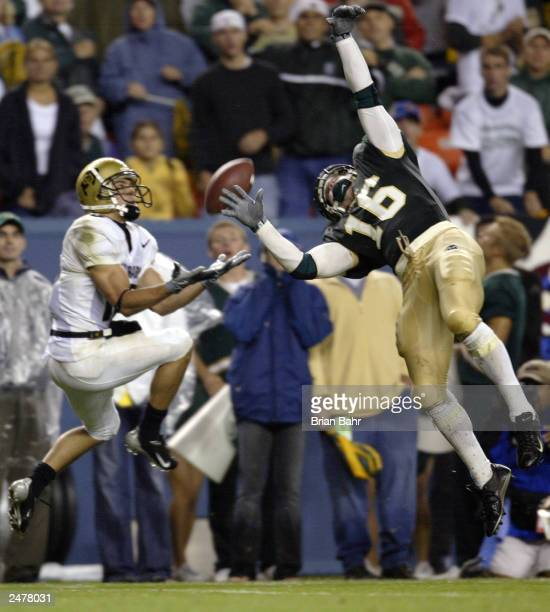 Wide receiver Jeremy Bloom of the University of Colorado Buffaloes pulls in a long pass despite the best efforts by defensive back Ben Stratton of...