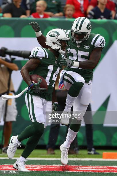 Wide receiver Jeremy Kerley of the New York Jets celebrates with teammate Elijah McGuire during the first quarter of their game against the New...
