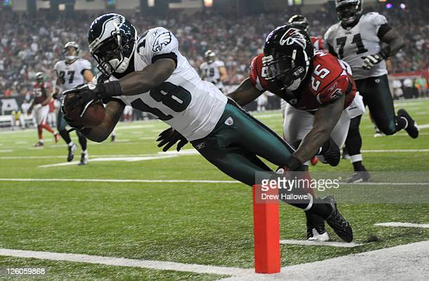 Wide Receiver Jeremy Macklin of the Philadelphia Eagles runs for a touchdown during the game against the Atlanta Falcons at the Georgia Dome on...