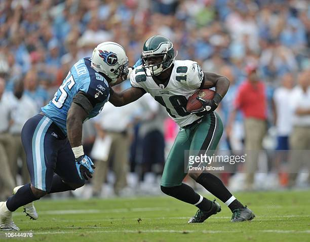Wide Receiver Jeremy Macklin of the Philadelphia Eagles stiff arms linebacker Stephen Tulloch of the Tennessee Titans at LP Field on October 24 2010...