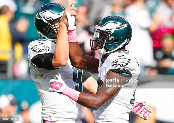 Wide receiver Jeremy Maclin and quarterback Nick Foles of the Philadelphia Eagles react after scoring a touchdown in the third quarter against the St...