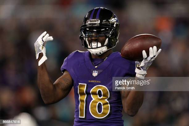 Wide Receiver Jeremy Maclin of the Baltimore Ravens celebrates after a first quarter touchdown against the Miami Dolphins at MT Bank Stadium on...