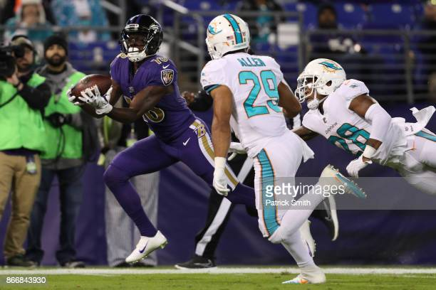 Wide Receiver Jeremy Maclin of the Baltimore Ravens scores a touchdown in the first quarter against the Miami Dolphins at MT Bank Stadium on October...