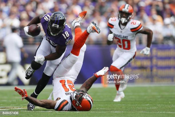 Wide receiver Jeremy Maclin of the Baltimore Ravens tries to get around cornerback Jamar Taylor of the Cleveland Browns in the first quarter at MT...