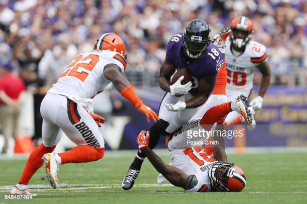 Wide receiver Jeremy Maclin of the Baltimore Ravens tries to get around free safety Jabrill Peppers of the Cleveland Browns cornerback Jamar Taylor...