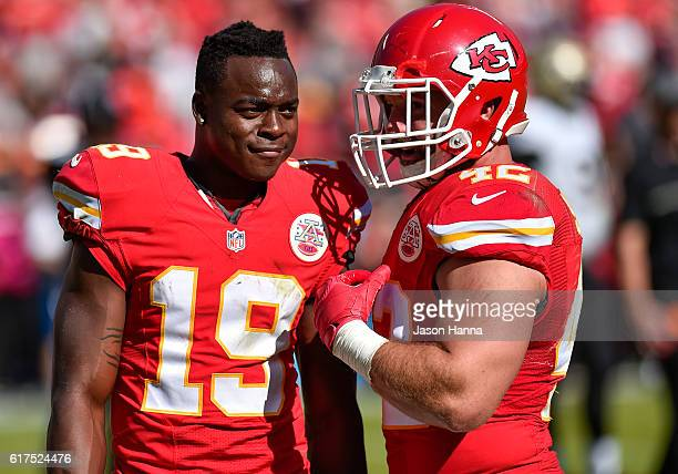 Wide receiver Jeremy Maclin of the Kansas City Chiefs and teammate Anthony Sherman talk during a play review at Arrowhead Stadium during the fourth...