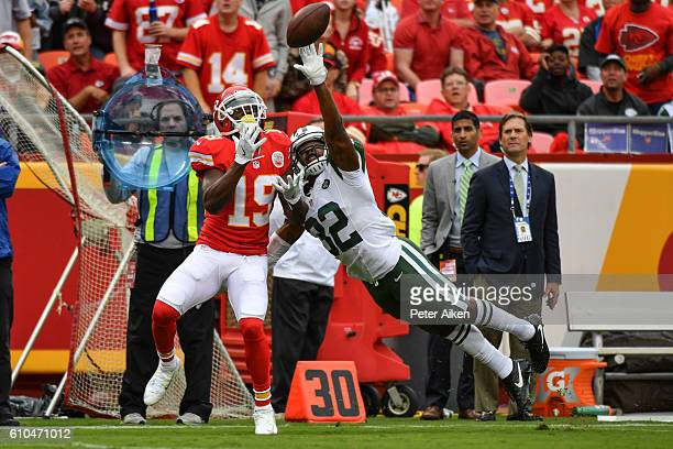 Wide receiver Jeremy Maclin of the Kansas City Chiefs attempts to catch a pass with cornerback Juston Burris of the New York Jets in tight coverage...