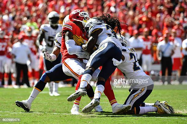 Wide receiver Jeremy Maclin of the Kansas City Chiefs is hit by strong safety Jahleel Addae of the San Diego Chargers on a play that would lead to a...