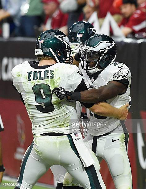 Wide receiver Jeremy Maclin of the Philadelphia Eagles celebrates with quarterback Nick Foles after scoring a 54 yard touchdown reception in the...