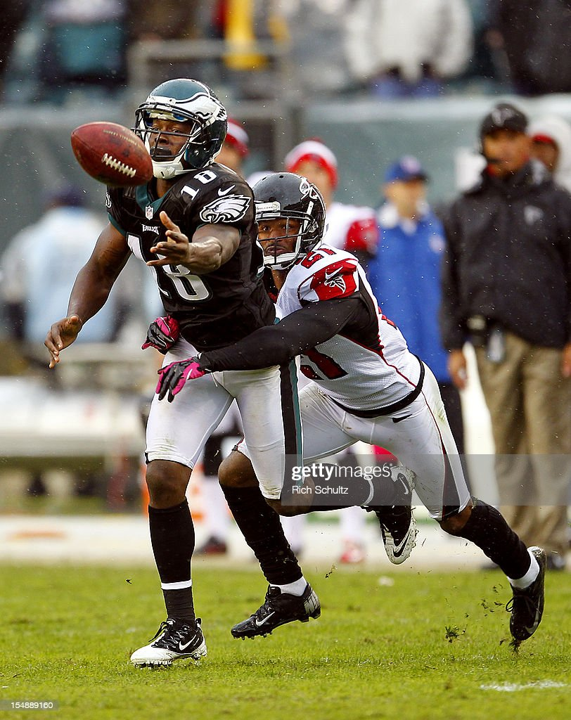 Wide receiver Jeremy Maclin #18 of the Philadelphia Eagles flips the ball away before being tackled by Chris Owens #21 of the Atlanta Falcons as a desperation move on the game's final play at Lincoln Financial Field on October 28, 2012 in Philadelphia, Pennsylvania. The Falcons defeated the Eagles 30-17.