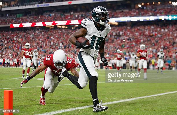 Wide receiver Jeremy Maclin of the Philadelphia Eagles scores a 21 yard reception against free safety Rashad Johnson of the Arizona Cardinals in the...