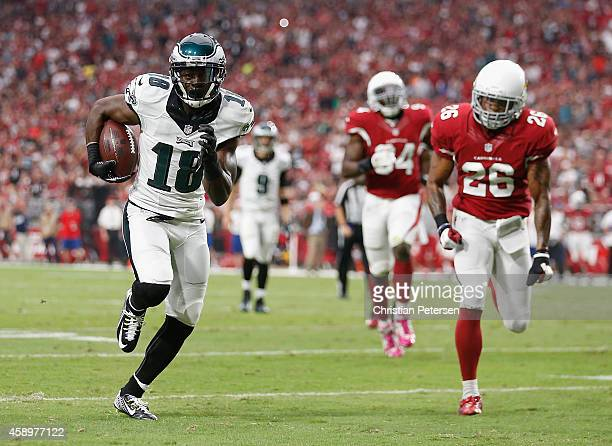 Wide receiver Jeremy Maclin of the Philadelphia Eagles scores a 21 yard reception past free safety Rashad Johnson of the Arizona Cardinals in the...