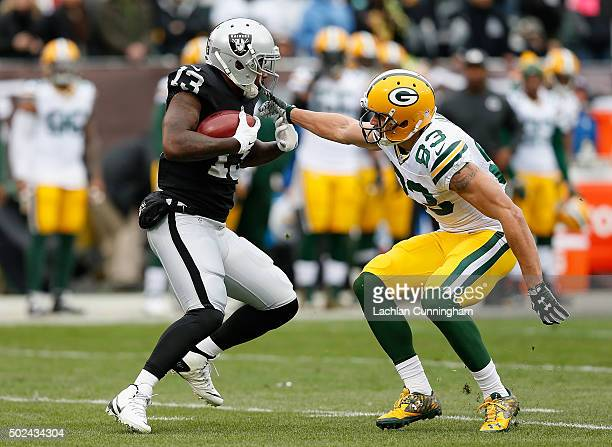 Wide receiver Jeremy Ross of the Oakland Raiders looks to evade wide receiver Jeff Janis of the Green Bay Packers in the first quarter at Oco...