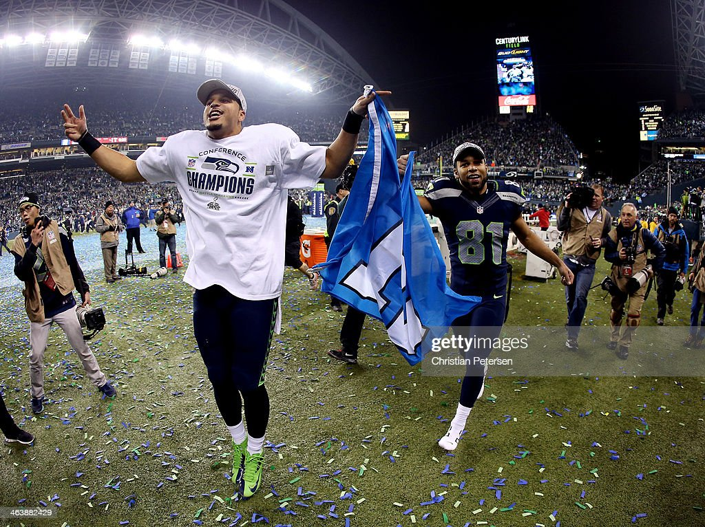 Wide receiver Jermaine Kearse #15 and wide receiver Golden Tate #81 of the Seattle Seahawks celebrate after the Seahawks 23-17 victory against the San Francisco 49ers during the 2014 NFC Championship at CenturyLink Field on January 19, 2014 in Seattle, Washington.