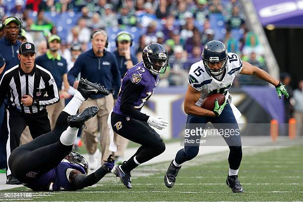 Wide receiver Jermaine Kearse of the Seattle Seahawks carries the ball past defensive back Shareece Wright and inside linebacker C.J. Mosley of the...