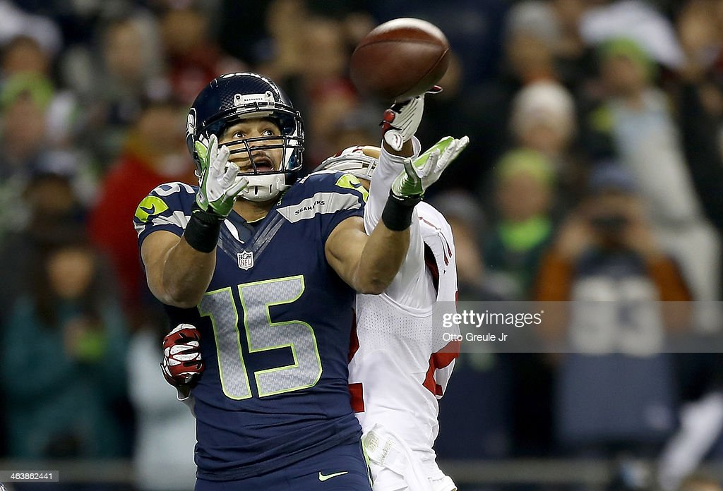 Wide receiver Jermaine Kearse #15 of the Seattle Seahawks catches a fourth quarter touchdown against cornerback Carlos Rogers #22 of the San Francisco 49ers during the 2014 NFC Championship at CenturyLink Field on January 19, 2014 in Seattle, Washington.