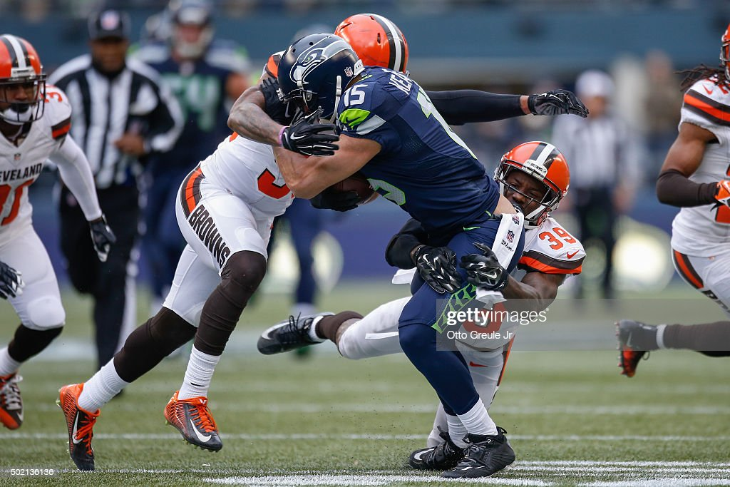 Wide receiver Jermaine Kearse #15 of the Seattle Seahawks is tackled by linebacker Christian Kirksey #58 and free safety Tashaun Gipson #39 of the Cleveland Browns at CenturyLink Field on December 20, 2015 in Seattle, Washington. The browns were penalized on the play, resulting in a field goal on the last play of the first half.