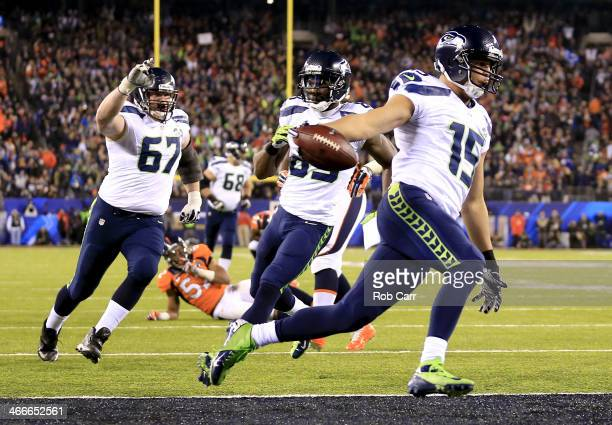 Wide receiver Jermaine Kearse of the Seattle Seahawks runs 23 yards to score a third quarter touchdown against the Denver Broncos during Super Bowl...