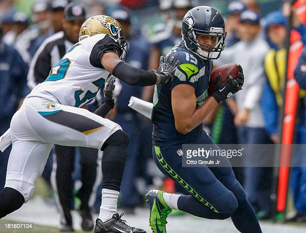 Wide receiver Jermaine Kearse of the Seattle Seahawks rushes against cornerback Demetrius McCray of the Jacksonville Jaguars at CenturyLink Field on...