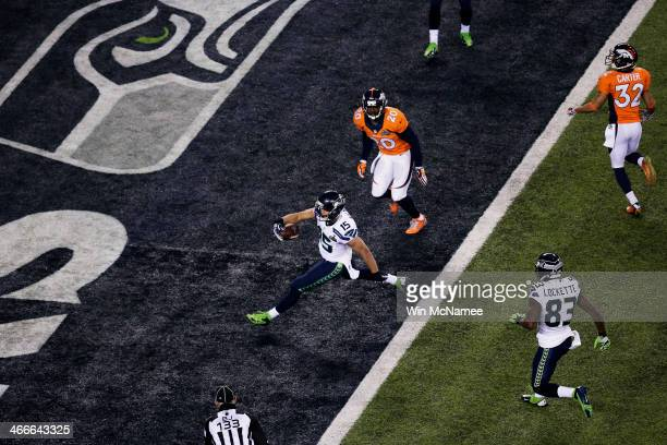 Wide receiver Jermaine Kearse of the Seattle Seahawks scores a 23 yard touchdown during Super Bowl XLVIII against the Denver Broncos at MetLife...