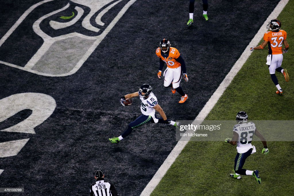 Wide receiver Jermaine Kearse #15 of the Seattle Seahawks scores a 23 yard touchdown during Super Bowl XLVIII against the Denver Broncos at MetLife Stadium on February 2, 2014 in East Rutherford, New Jersey.
