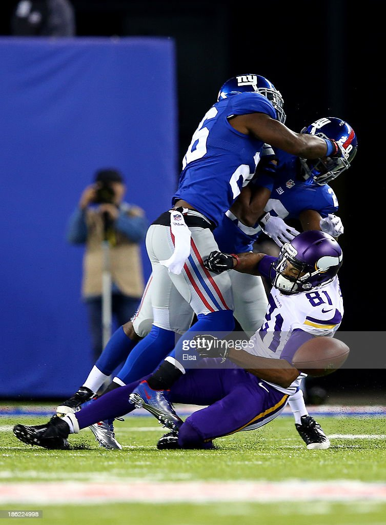 Wide receiver Jerome Simpson #81 of the Minnesota Vikings is tackled by cornerback Prince Amukamara #20 and strong safety Antrel Rolle #26 of the New York Giants during a game at MetLife Stadium on October 21, 2013 in East Rutherford, New Jersey.
