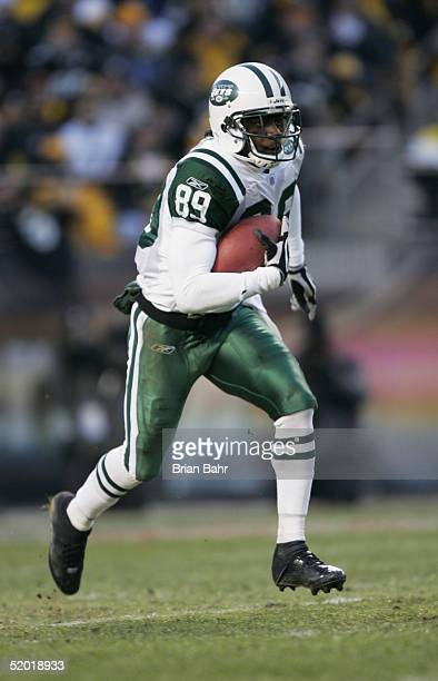 Wide receiver Jerricho Cotchery of the New York Jets returns a punt against the Pittsburgh Steelers in an AFC divisional game at Heinz Field on...