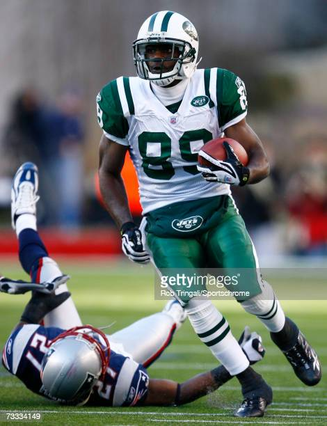 Wide receiver Jerricho Cotchery of the New York Jets runs with the ball against the New England Patriots in the AFC Wild Card Playoff Game at...