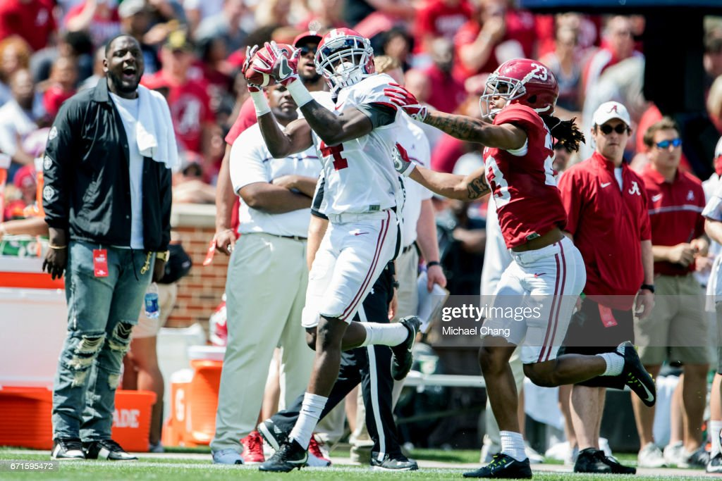 Wide receiver Jerry Jeudy #4 of the Alabama Crimson Tide catches a pass in front of defensive back Aaron Robinson #23 of the Alabama Crimson Tide at Bryant-Denny Stadium on April 22, 2017 in Tuscaloosa, Alabama.
