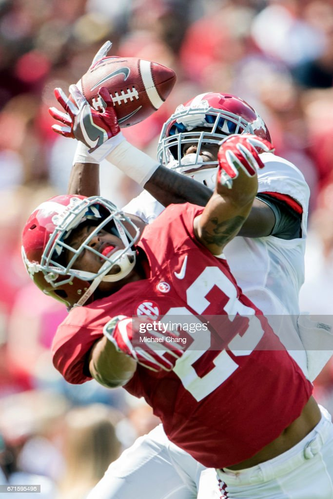 Wide receiver Jerry Jeudy #4 of the Alabama Crimson Tide catches a pass in over defensive back Aaron Robinson #23 of the Alabama Crimson Tide at Bryant-Denny Stadium on April 22, 2017 in Tuscaloosa, Alabama.