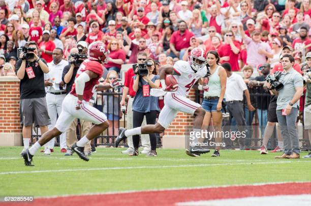 Wide receiver Jerry Jeudy of the Alabama Crimson Tide runs the ball past defensive back Xavier McKinney of the Alabama Crimson Tide at BryantDenny...