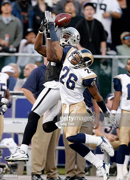 Wide receiver Jerry Porter of the Oakland Raiders is interferred with by defensive back Tye Hill of the St Louis Rams on August 24 2007 at McAfee...