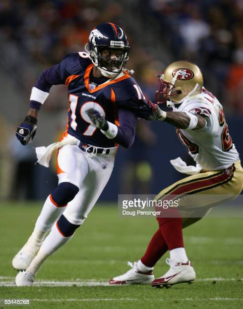 Wide receiver Jerry Rice of the Denver Broncos battles the defensive pressure of Mike Adams of the San Francisco 49ers as the Broncos took a 107...