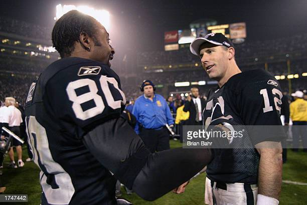 Wide receiver Jerry Rice of the Oakland Raiders congratulates quarterback Rich Gannon after defeating the Tennessee Titans in the AFC Championship...