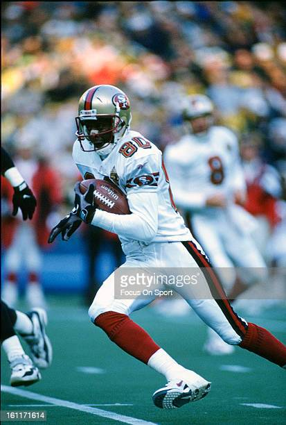 Wide Receiver Jerry Rice of the San Francisco 49ers carries the ball against the Pittsburgh Steelers during an NFL football game December 16 1996 at...