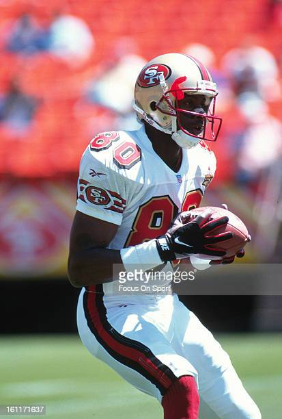 Wide Receiver Jerry Rice of the San Francisco 49ers catching a pass in pregame warmup before preseason NFL football game circa 1996 at Candlestick...