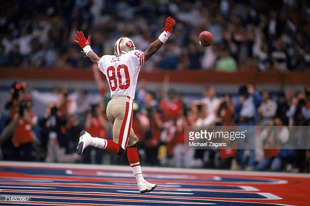 Wide receiver Jerry Rice of the San Francisco 49ers celebrates after scoring a touchdown against the Denver Broncos during Super Bowl XXIV at the...