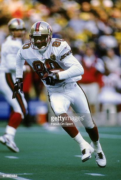 Wide Receiver Jerry Rice of the San Francisco 49ers in action carries the ball during a circa 1996 NFL football game Rice played for the 49ers from...