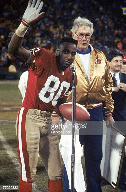 Wide receiver Jerry Rice of the San Francisco 49ers is honored for setting a NFL record of 101 career touchdown receptions as he talks to the fans...
