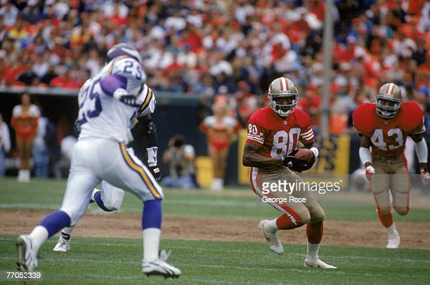 Wide receiver Jerry Rice of the San Francisco 49ers looks for room to run against the Minnesota Vikings at Candlestick Park on October 3 1993 in San...