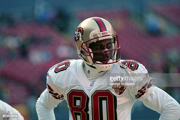 Wide receiver Jerry Rice of the San Francisco 49ers looks on from the field before a game against the Pittsburgh Steelers at Three Rivers Stadium on...