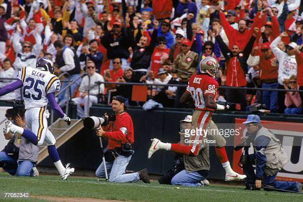 Wide receiver Jerry Rice of the San Francisco 49ers runs for a 39yard touchdown reception against the Minnesota Vikings at Candlestick Park on...