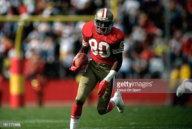 Wide Receiver Jerry Rice of the San Francisco 49ers runs up field after a reception during an NFL football game circa 1993 at Candlestick Park in San...