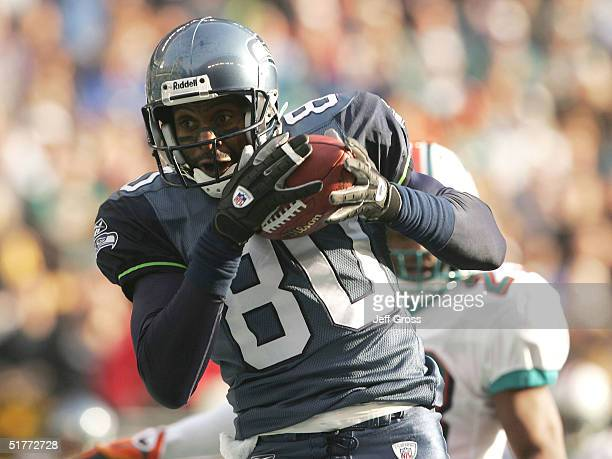 Wide receiver Jerry Rice of the Seattle Seahawks catches a pass for a touchdown in the first quarter against the Miami Dolphins at Qwest Field on...